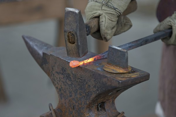 Blacksmith shaping iron