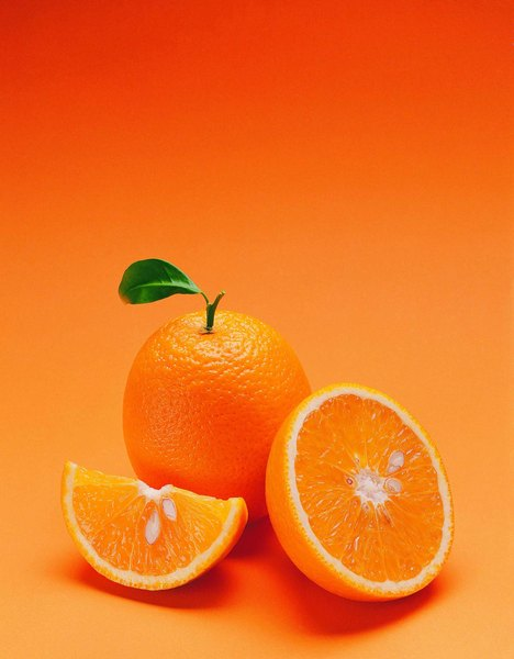 Illustrate simple fractions by slicing an orange into sections.