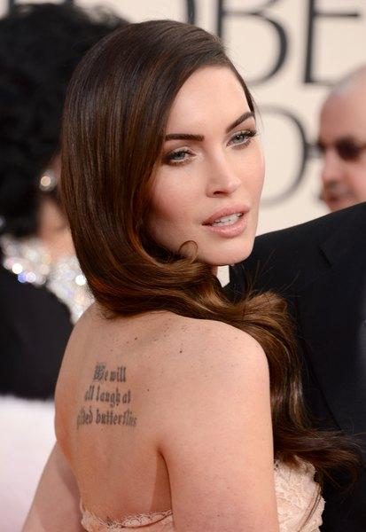 Megan Fox decidiu apagar a tatuagem com o rosto de Marilyn Monroe, mas ainda possui várias tatoos