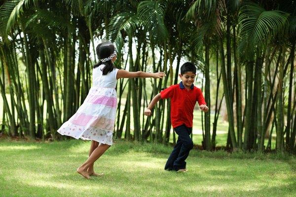 Child running from blind-folded child