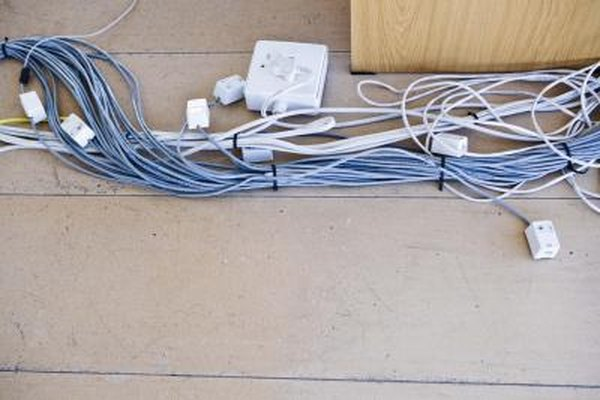 How to Conceal Electrical Wires on the Outside of a Wall ... Hiding Wiring on hiding basement plumbing, hiding cords on mounted tv wall, hiding behind a wall, hiding behind your wall, hiding wall corner, hiding behind a corner, hiding wall speakers, hiding foundation,