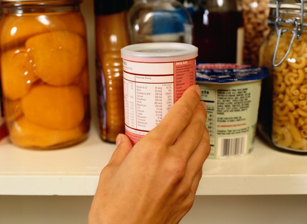 Woman getting ingredient out of pantry