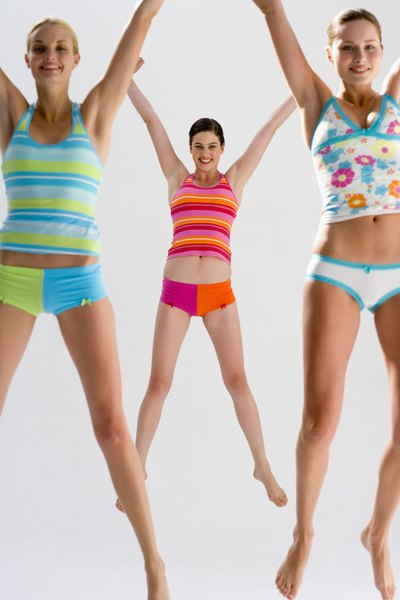 What Muscle Groups Are Used During Jumping Jacks? - Woman