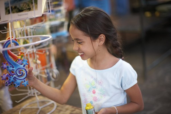 Young girl looking at colorful toy in store.