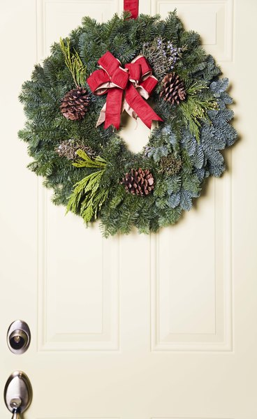 cheap outside christmas decorations by emily weller craft an elegant wreath to hang from your front door - Christmas Decorations On The Cheap