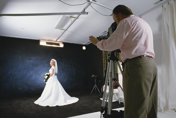 portrait photographer photographers working conditions hours often studios works portraits photographs bridal getty