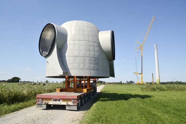 The rotor hub of a turbine being transported to a farm.