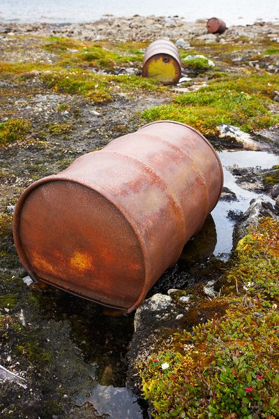Rusting oil barrels in the tundra