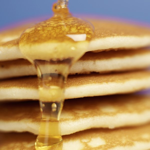 When cold syrup is heated, it becomes less viscous and easier to pour.