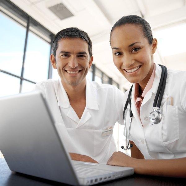 Medical professionals on a computer