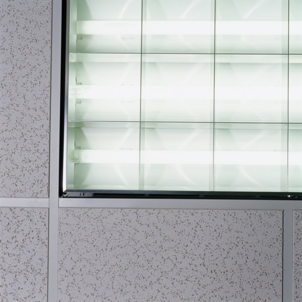 A Grid Supporting Fluorescent Light Panels Should Hang Six Inches Below The Existing Ceiling