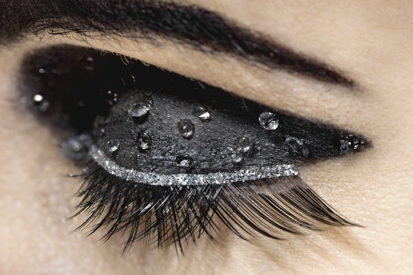 Eye with heavy mascara and water beads