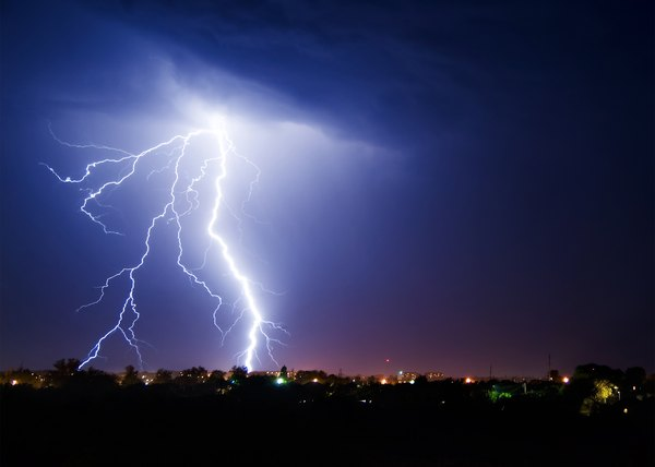 Lightning stikes over a small town.