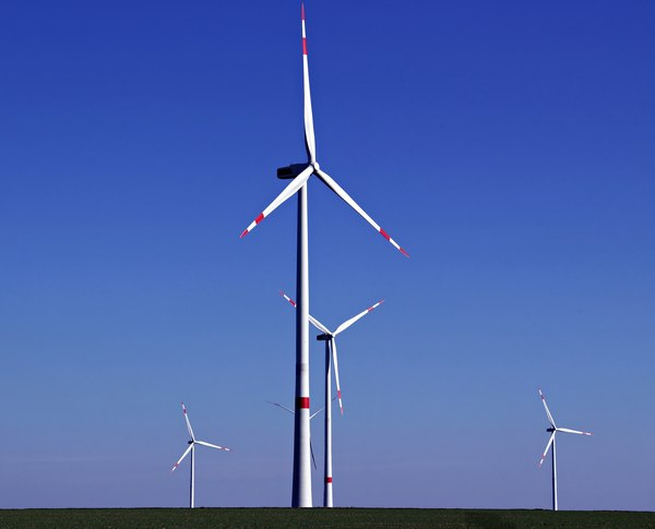 Wind turbines use electromagnetic induction to transform mechanical energy into electric energy.