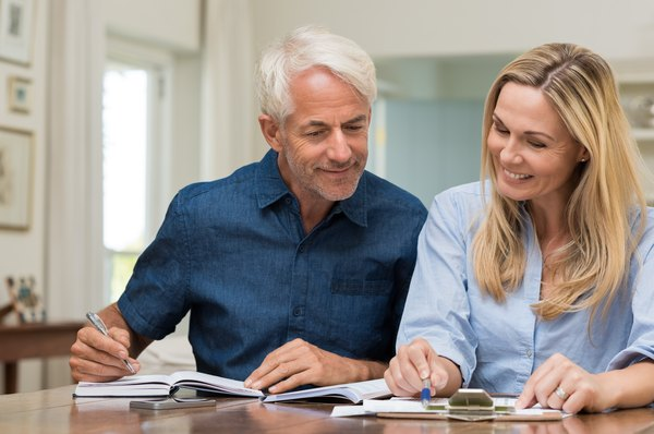 What Is the Difference Between an IRA Rollover & an IRA Transfer of Funds?