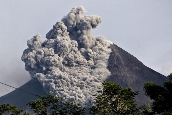 A pyroclastic flow sweeps down the side of a volcano