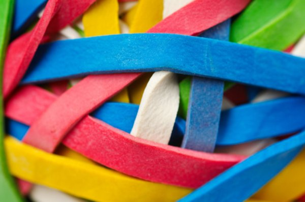 Longer rubber bands should produce lower and longer sounds.