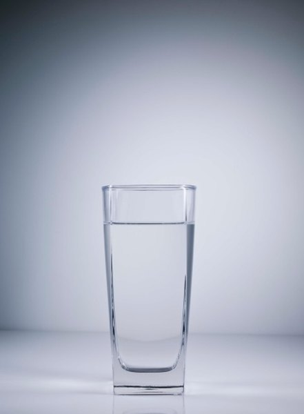 A water glass is a good option, but make sure to wash it thoroughly before drinking from it!