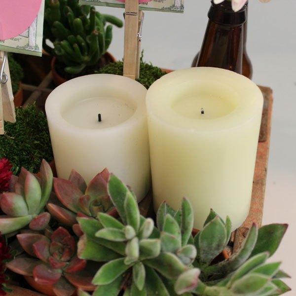 As velas deverão ficar apoiadas no caixote
