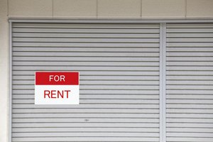 Window displaying a for rent sign.