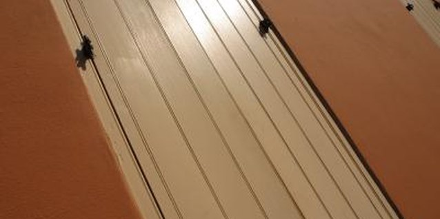 Cut lines in plywood for a decorative beadboard-style door.