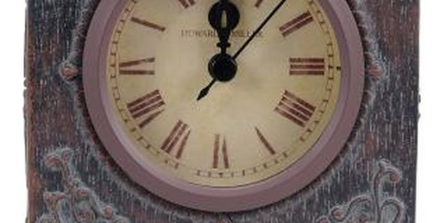 Coffee or tea creates a yellowing effect on a paper clock face.