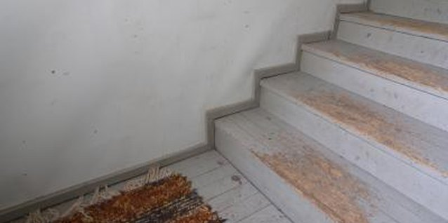 How to Close the Gap Between Wood Stairs & a Wall