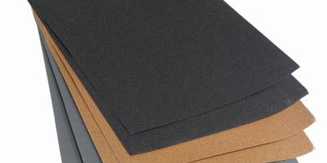 Aluminum oxide sandpaper is the most effective for wooden furniture.