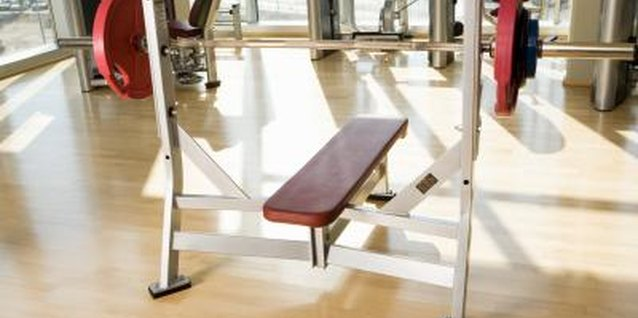 A weight bench with a rack and weights gives the ab-lover many exercise options.
