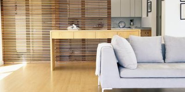 A retractable bamboo screen divides the two rooms without blocking the view.