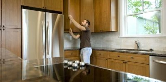 Revarnishing your cabinets can be an inexpensive alternative to replacing them.