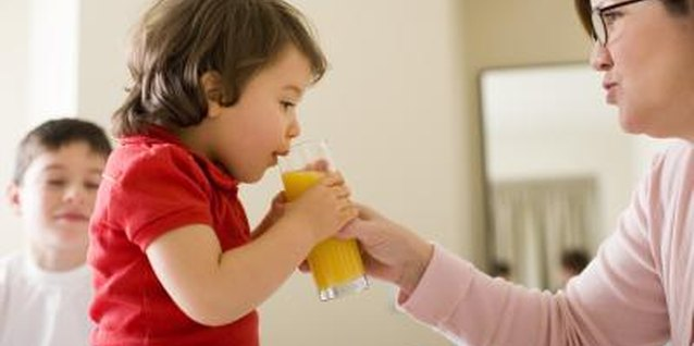 Help your toddler drink 100 percent juice from a glass or cup.