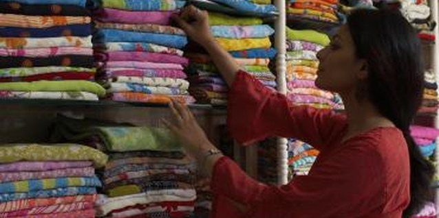 Hunt for unusual curtain fabric in ethnic textile shops.