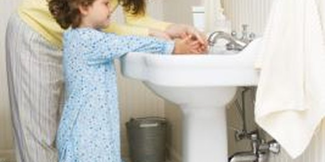 Insisting your tot constantly wash her hands is a sign of overprotective parenting.
