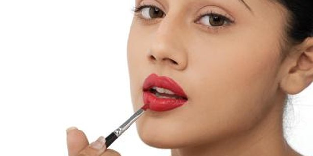 Lip Tar offers opaque coverage for bold lips.