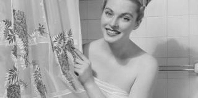 While they weren't done in shades of gray, the bathrooms of the '50s were often tiled.