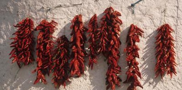 Red chili peppers offer hot decorating accents in a Southwestern style kitchen.