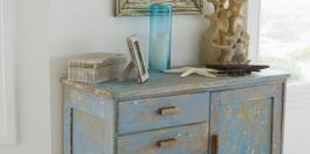 Distressing techniques bring antique charm to an old worn dresser.