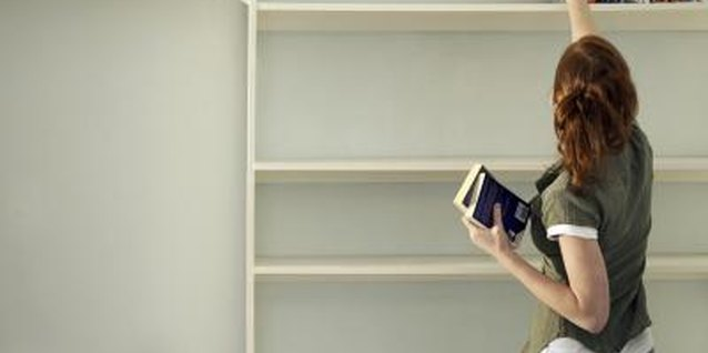 Display your favorite books on the top shelves and cover the lower half with curtains for storage.