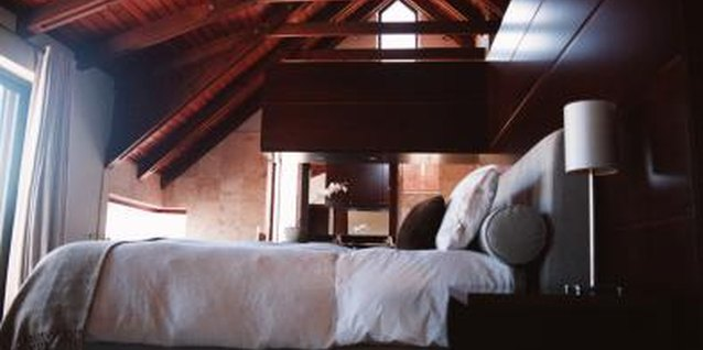 Enhance the beauty of a sloped ceiling with wood paneling.