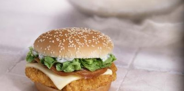 A spicy chicken sandwich can be a whole meal stacked on a bun.