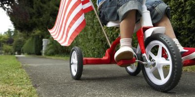 Learning to ride a tricycle is easy and it gives your toddler a sense of independence.