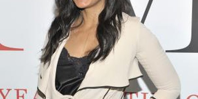 A camisole saves Rachel Roy from a wardrobe malfunction at a gala in New York.