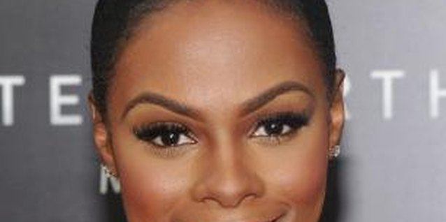"Actress Tika Sumpter wears a sleek top-knot bun to the ""After Earth"" movie premiere."