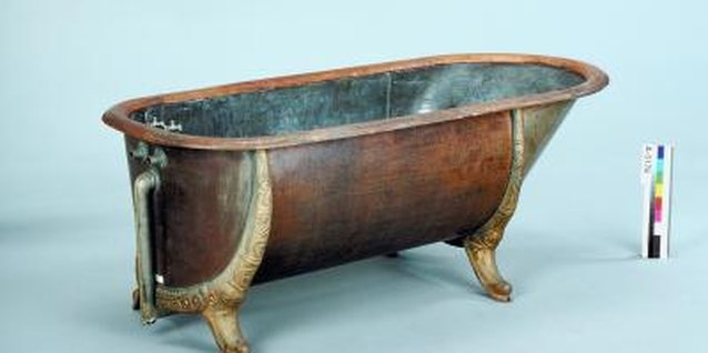 Cast-iron tubs can be painted or left as is for a rustic look.