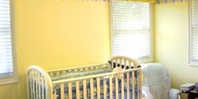 Fill a blank space on the nursery wall with fabric art.