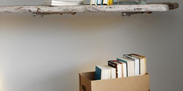 Shelf brackets and scrap wood create inexpensive shelves.