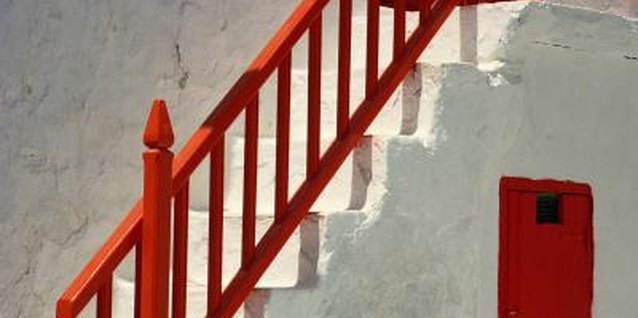 Painting the outsides of railing balusters takes a longer-than-normal reach.