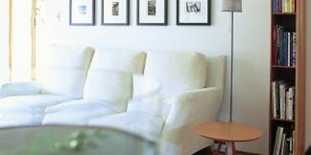 A simple grouping with matching frames decorates the space above the sofa perfectly.