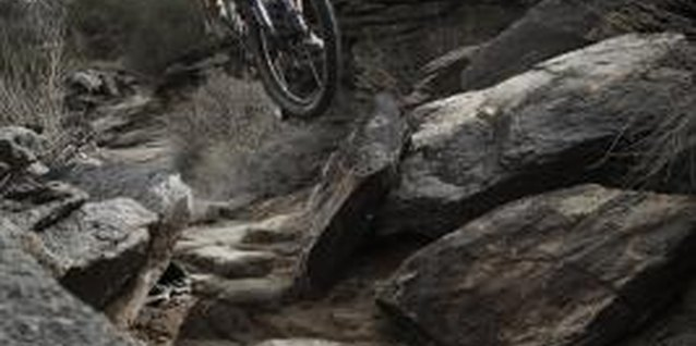 Steep descents through rugged terrain require a sturdy bike.